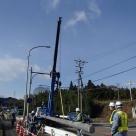 岐阜国道事務所管内における交通量計測装置(トラカン)のコンクリート柱の建柱作業状況